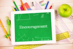 Encouragement against students desk with tablet pc Kuvituskuvat