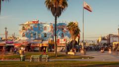 Walk along Venice Beach Boardwalk at sunset. Motion timelapse (hyperlapse) view Stock Footage