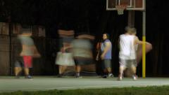 Group of young men playing street basketball aka streetball at night. Timelapse Stock Footage