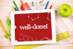 Well-done! against students desk with tablet pc - stock photo