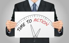 businessman holding time to action poster - stock illustration