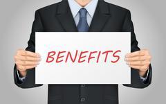 businessman holding benefits word poster - stock illustration