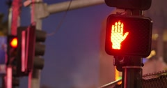 Traffic signal light changes from red to green at night. 4K UHD. - stock footage
