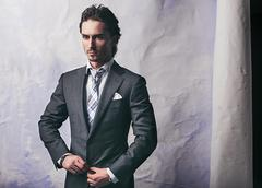 Young handsome guy in  stylish suit Stock Photos