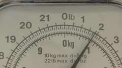 Close up household scale weighing food - stock footage