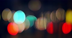 City blur background. Flickering bokeh circles of night traffic. 4K UHD Stock Footage