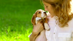 Portrait of a woman with her beautiful dog outdoors Stock Footage