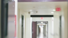 Slow POV walk inside white hospital corridor. Defocused blurred vision. Stock Footage