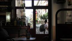 Looking Out From Inside a Cosy Old Barcelona Street Cafe Stock Footage