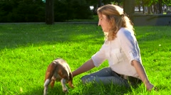 Portrait of a woman with her beautiful beagle  in park Stock Footage