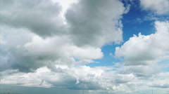 Oncoming white cumulus clouds (time-lapse) Stock Footage