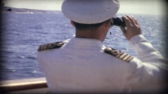 Boat captain looking through binoculars over the sea in Finland Stock Footage