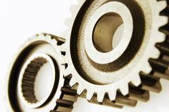 Closeup of two metal cog gears Kuvituskuvat