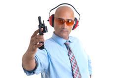 Man with gun and protective goggles Stock Photos