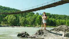 Young Couple near Katun and suspension bridge Stock Footage