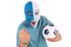 Football supporter with ball and painted face Kuvituskuvat