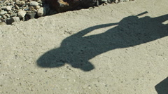 Shadow of girl is on a stone - stock footage