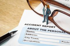 Accident report application form and businessman with pen and eyeglass, busin - stock photo