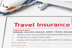 Travel Insurance Claim application form on brown envelope, business insurance - stock photo