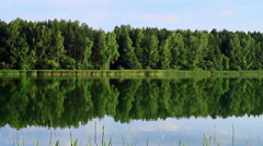 Beautiful coastline is reflected in the water. - stock footage