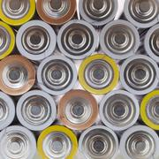 large amount of used AA batteries in several colors - stock photo