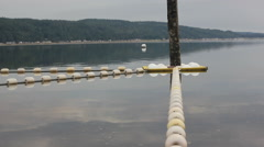 Buoys and gray water Stock Footage