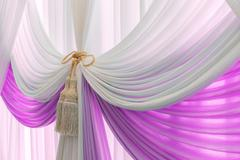 Luxury sweet white and violet curtain and tassel Stock Photos