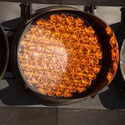 Orange Traffic Light with LED Lights - stock photo
