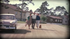 Three people walking on a road in Sweden in 1958  8mm old film Stock Footage
