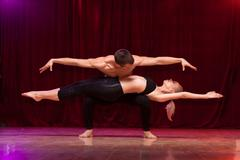 Balanced pose of an athletes couple performing an artistical duet. Stock Photos
