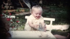 Small child drinking from a glass outdoors in Sweden Stock Footage