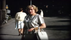 Woman posing in the city of Stockholm in 1958   old 8mm film Stock Footage