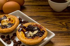 Traditional Portuguese egg tart to be eaten with coffee. - stock photo
