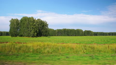 Moving along a scenic agricultural fields (POV) - stock footage