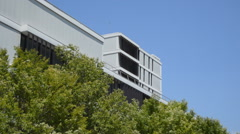 Modern Building Behind Some Tress Stock Footage