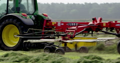 Agriculture tractor raking and haying Netherlands 4K Stock Footage