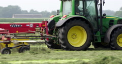 Agriculture tractor raking and haying Netherlands Stock Footage