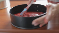 Pastry dough levels of red color in the form Stock Footage