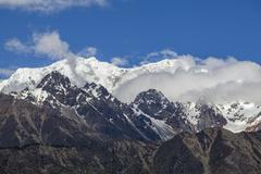 Blue sky and snow mountains in Tibet, China - stock photo