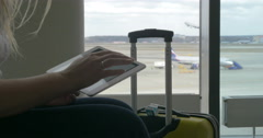 Woman waiting for the flight with tablet PC Stock Footage