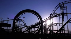 Roller coaster with blue sky. Amusement park. Arkistovideo