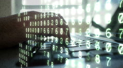 Laptop PC typing close up overlaid with binary code and numbers. Stock Footage