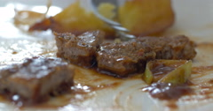 Eating a dish with meat and potatoes Stock Footage