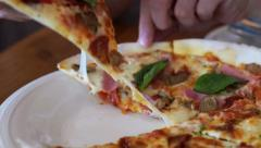 Hand taking crispy cheese pizza slice Stock Footage