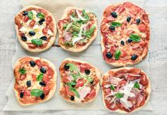 variety of small pizzas - stock photo