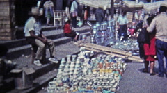 1974: Marketplace of live chickens, baskets, caged exotic parakeet bird. Stock Footage