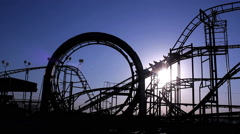 Full moviment. Roller coaster with blue sky. Amusement park. Stock Footage