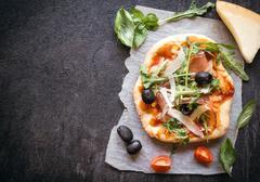 Prosciutto mini pizza - stock photo