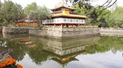 Pavilion on lake, Norbulingka Palace, Tibet Stock Footage