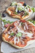 Prosciutto mini pizza - stock photo